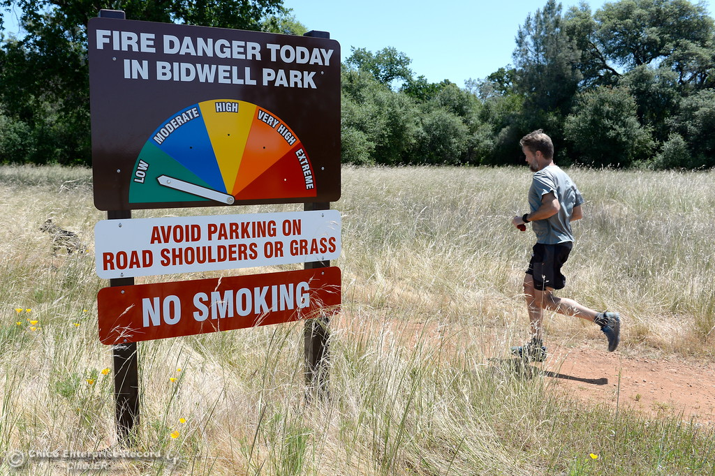 . The Fire Danger sign in Upper Bidwell Park remain set on low however wind and warmer days recently mean vegetation is certainly getting dryer in Chico, Calif. Monday May 8, 2017. (Bill Husa -- Enterprise-Record)
