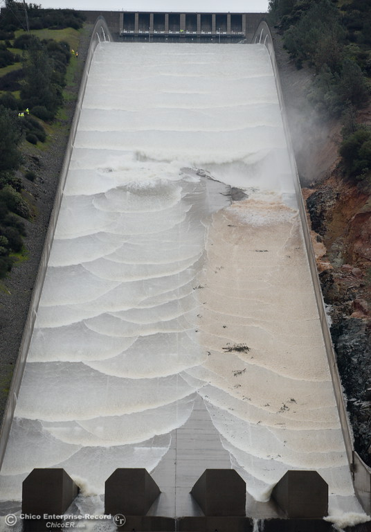 . Debris and muddy water flow out of the hole as DWR performs a 20,000 cfs test on the damaged Oroville Dam Spillway Wednesday Feb. 8, 2017. (Bill Husa -- Enterprise-Record)