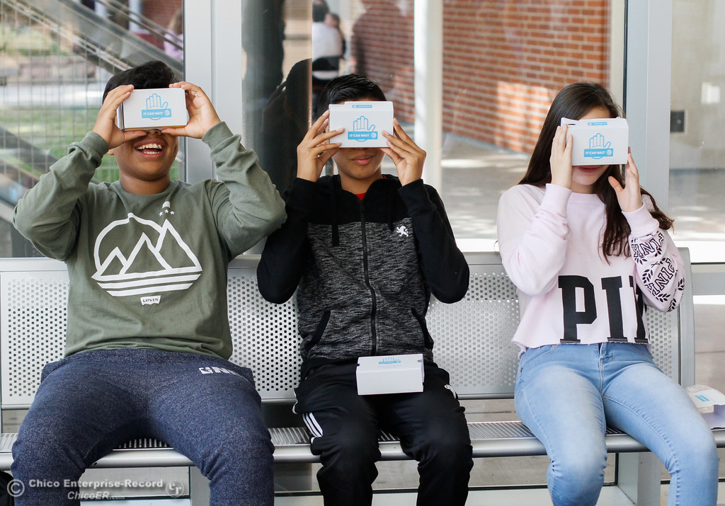 . Chico High freshman Brian Mancilla, Daniel Villegas and Alondra Maldonado in Vallerie Jensen\'s health education class experience distracted driving first hand through AT&T\'s virtual reality program It Can Wait Tuesday October 3, 2017 in Chico, California. (Emily Bertolino -- Enterprise-Record)