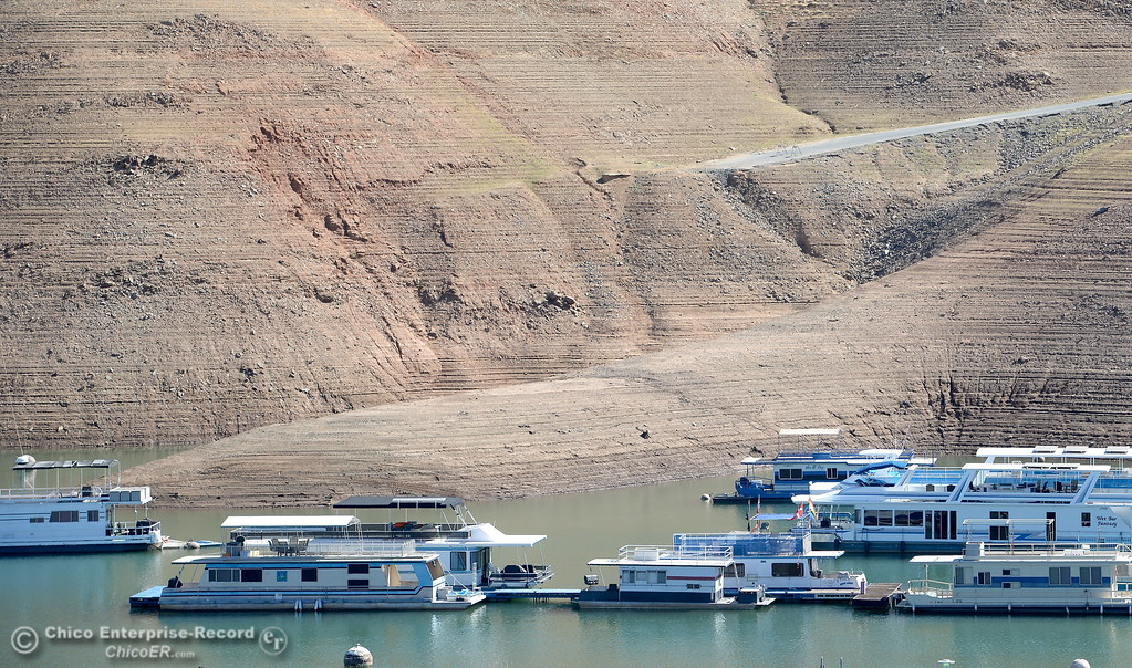 . The Loafer Creek Boat Ramp is seen behind houseboats above the water near Bidwell Canyon Marina at Lake Oroville Friday Oct. 6, 2017. (Bill Husa / Chico Enterprise--Record)
