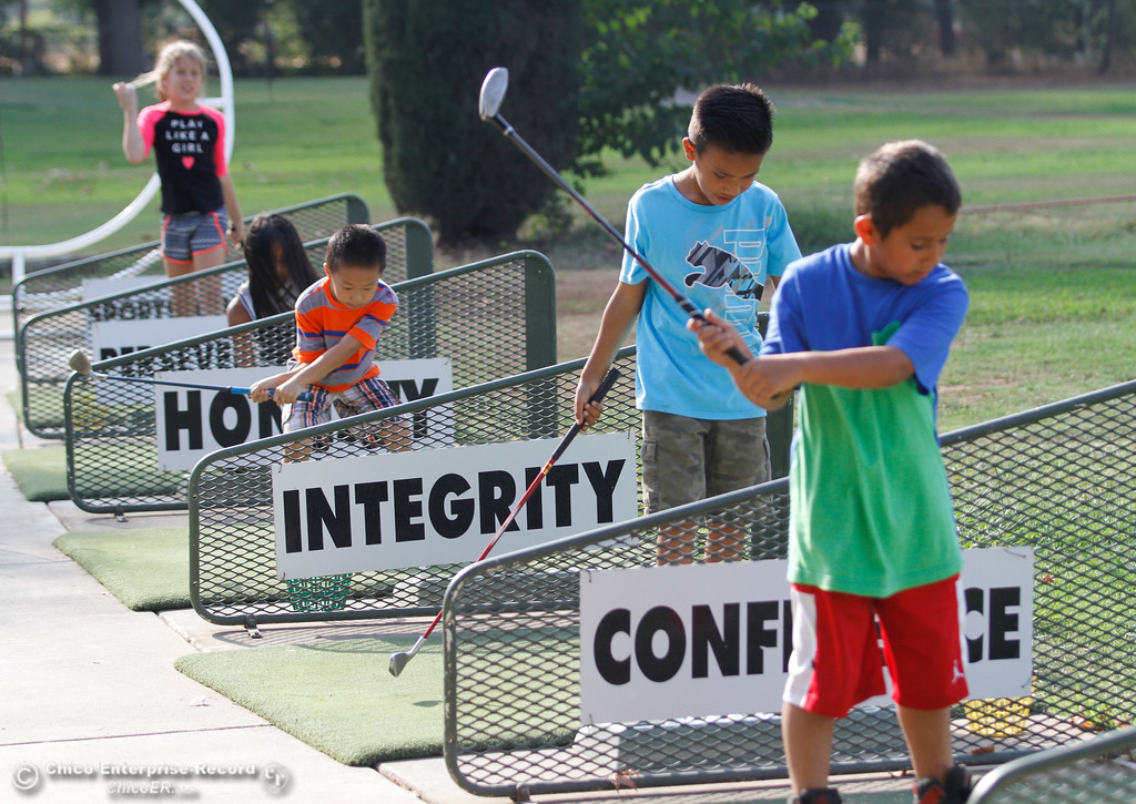 . Chapman Elementary School students test their skills on the driving range during the First Tee program Thursday September 14, 2017 at the Practice Tee at Sunset Hills in Chico, California. (Emily Bertolino -- Enterprise-Record)