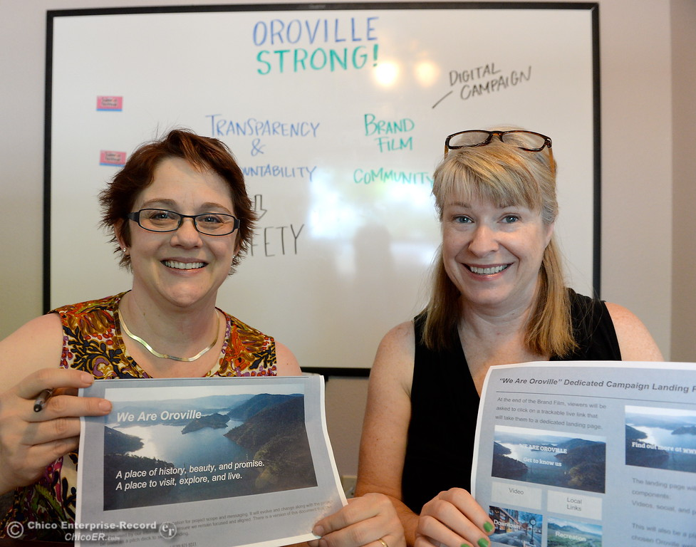 ". Oroville Chamber President and CEO Sandy Linville left and Digital Communications consultant for Langlers Webworks Heather Johnson smile as they work on the ""Oroville Strong\"" project at the Oroville Chamber of Commerce in Oroville, Calif. Thurs. May 4, 2017.   (Bill Husa -- Enterprise-Record)"