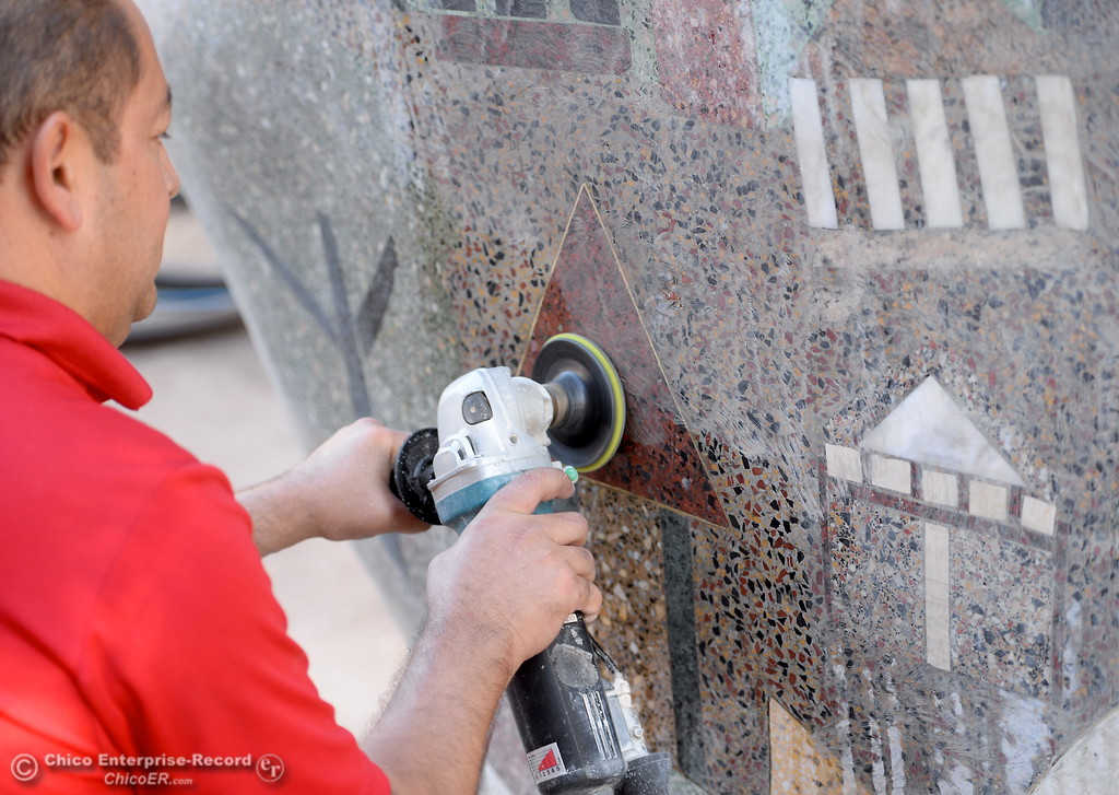 . Ramon Ferguson Operations Manager for Select Janitorial works on restoration of the Our Hands sculpture by artist Donna Billick near the Municipal Building in downtown Chico, Calif. Tues. Oct. 24, 2017. (Bill Husa -- Enterprise-Record)