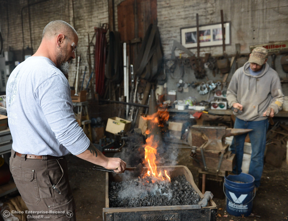 . Chico Blacksmith association members Shawn Casey and Jon Trojanowski work on forging metal  November 11, 2017 at Richer\'s Earthen Iron in Chico, California. (Emily Bertolino -- Mercury Register)