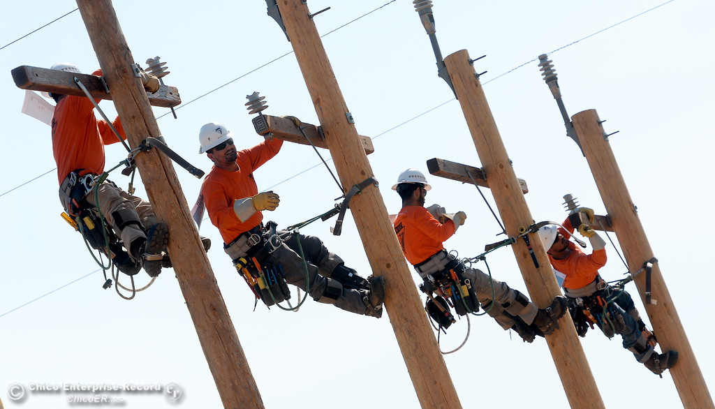 . Climbers compete during the Northwest Lineman College Rodeo held at the NLC training center in Oroville, Calif. Friday July 14, 2017. (Bill Husa -- Enterprise-Record)