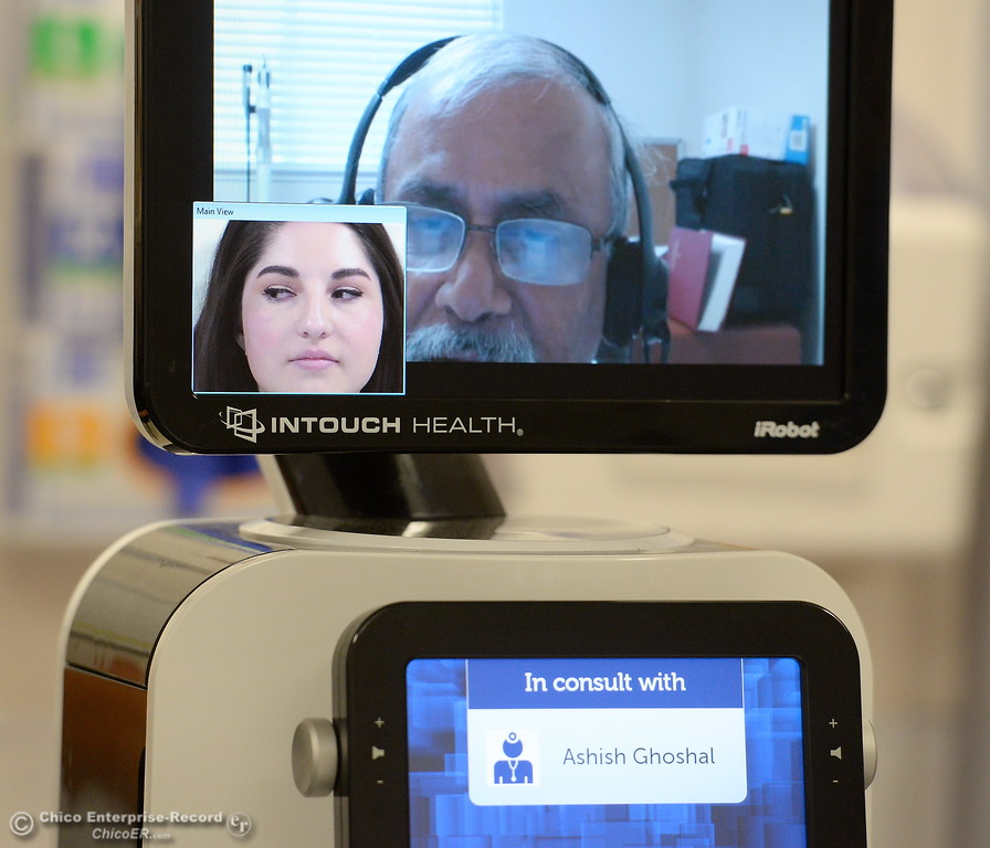 . Oroville Hospital Marketing Assistant Raquel Borrayo plays the role of a patient while Dr. Ashish Ghoshal goes through a diagnostic procedure as they demonstrate the capabilities of a new robot in the emergency room at Oroville Hospital Wednesday Aug. 9, 2017. (Bill Husa -- Enterprise-Record)