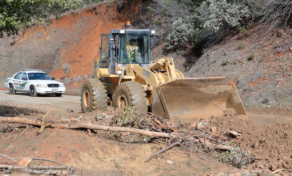 . Butte County Public Works Loader Operator Kevin Thomas works to clear a mudslide on hwy 162 near Berry Creek Wed. Jan 11, 2017. (Bill Husa -- Enterprise-Record)