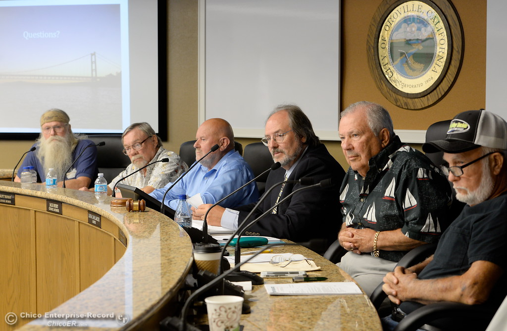 . Members of the Oroville Recreation Advisory Committee ORAC, Doug Poppelreiter, Wade Hough, Bill Connelly, Kevin Zeitler Larry Grundmann, Don Reighley left to right and Jack Berry (not pictured) talk with DWR representatives during the 196th meeting of the group at the Oroville City Council Chambers in Oroville, Calif. Friday July 21, 2017. Following the meeting agenda schedule the group discussed tourism and recreation, lake conditions and projections, recreational projects status and voted on a request to delay the FERC license. (Bill Husa -- Enterprise-Record)