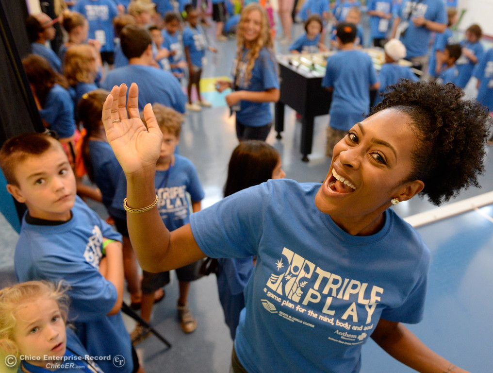 . Director of Marketing Brittney Young smiles as Boys & Girls Club members get a chance to try out some of the new equipment and games after they received a $20,000 grant from Anthem Blue Cross for items at the Boys & Girls Club in Chico, Calif. Tues. Aug. 8, 2017. (Bill Husa -- Enterprise-Record)