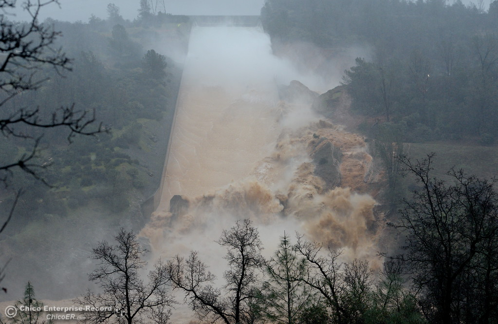 . Mud, rocks and concrete mingle with the water as the Lake Oroville Dam controlled Spillway crumbles Thursday Feb. 8, 2017.  Erosion along the left side continues to increase as the spillway falls apart. (Bill Husa -- Enterprise-Record)