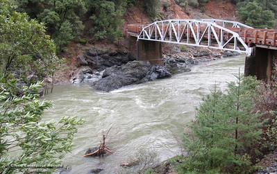 Water flows beneath the Jordan Hill Rd. bridge over the West Branch of the Feather River Sat. Feb. 18, 2017. (Bill Husa - Photo)