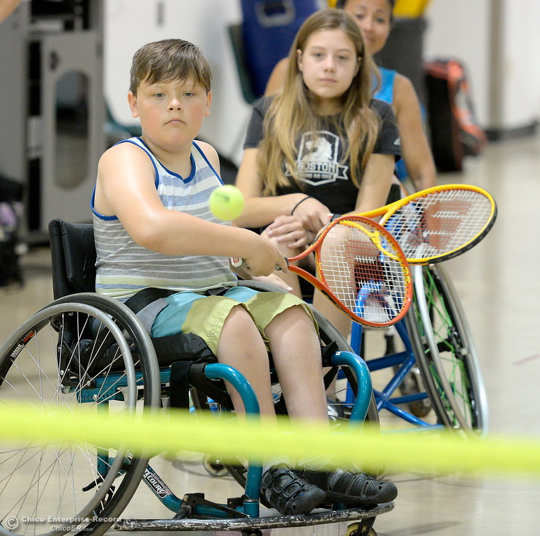 . 11-year-old Kanon Aiono of Sacramento eyes the ball as he plays some tennis during the Ability First Camp for kids with disabilities at CSUC Tuesday June 20, 2017. (Bill Husa -- Enterprise-Record)