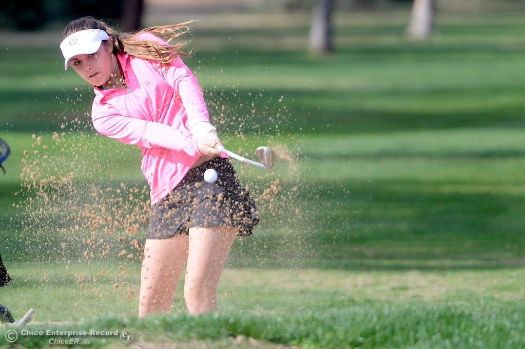 . Chico High golfer Patty Thatford digs one out of the sandtrap during the Northern Section girls golf championships at Table Mountain Golf Course in Oroville, Calif. Mon. Oct. 30, 2017. (Bill Husa -- Enterprise-Record)