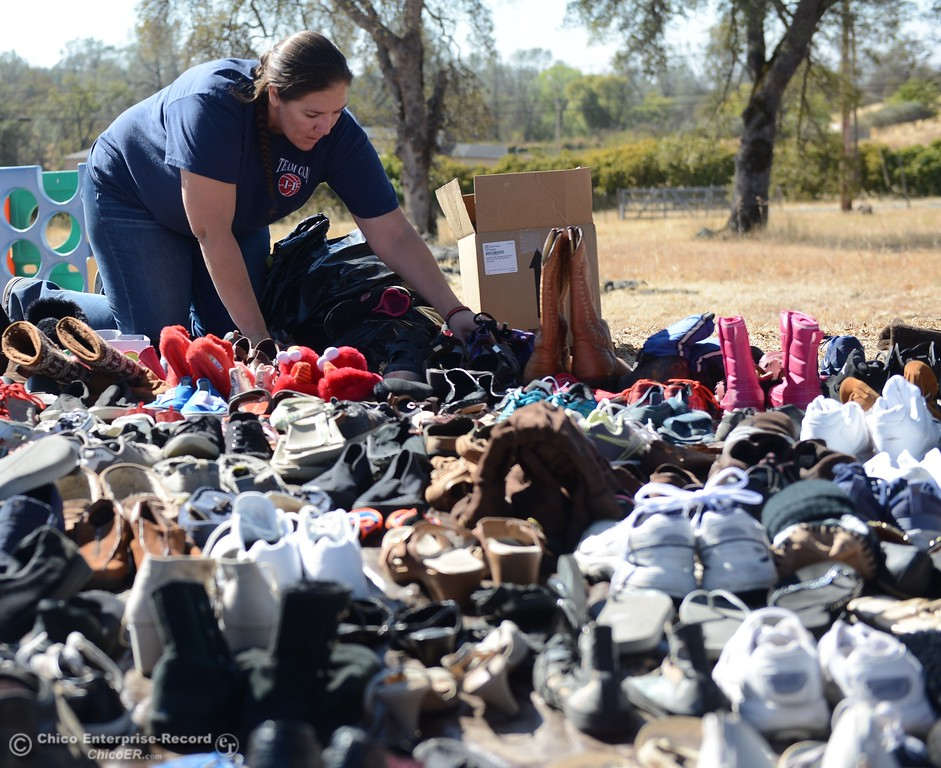 . Shannon Tiedeman helps organize shoe donations Saturday October 14, 2017 at the Bangor Community Church in Bangor, California. (Emily Bertolino -- Mercury-Register)