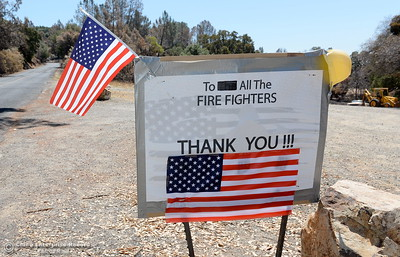 A sign thanking firefighters for their help during the Wall Fire is seen posted along Old Olive Highway in Oroville, Calif. Wed. July 26, 2017. (Bill Husa -- Enterprise-Record)