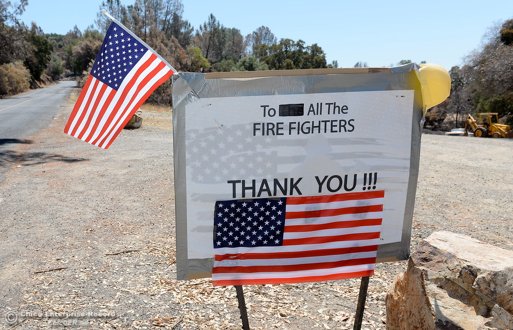 . A sign thanking firefighters for their help during the Wall Fire is seen posted along Old Olive Highway in Oroville, Calif. Wed. July 26, 2017. (Bill Husa -- Enterprise-Record)