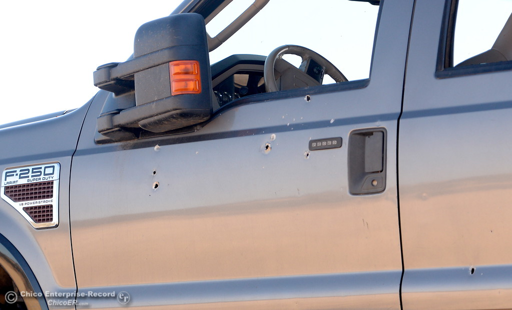 . Bullet holes are seen in the side of a pickup that was involved in the shooting along Rancho Tehama Road where law enforcement has the road blocked following several shootings in the Rancho Tehama community Tues. Nov. 14, 2017.  (Bill Husa -- Enterprise-Record)