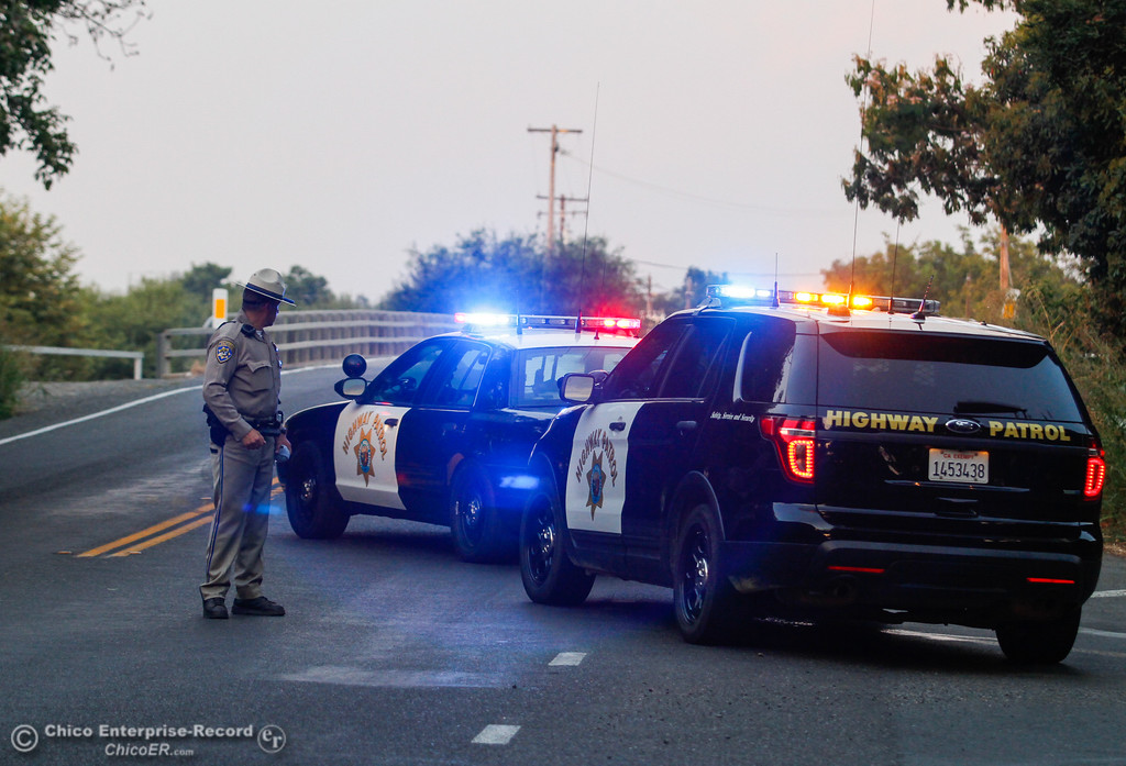 . California Highway Patrol blocks Durham-Dayton Highway at Stanford Lane as the sheriff\'s department investigates an officer involved shooting on the 1900 block of Durham-Dayton Highway Tuesday August 22, 2017 in Durham, California. (Emily Bertolino -- Enterprise- Record)
