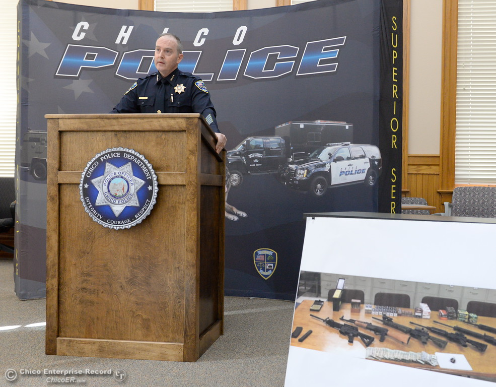 . Chico Police Chief Mike O\'Brien shows a photo of confiscated weapons as he talks about the Butte Interagency Narcotics Task Force annual review of drug related crimes and arrests during a press conference at the old Municipal Building in Chico, Calif. Thurs. April 20, 2017. (Bill Husa -- Enterprise-Record)