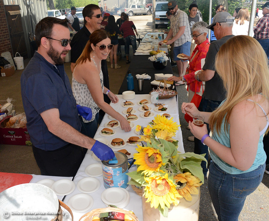 . Mom\'s Diner general manager Aaron Smith, left, and Sara Vickery, next to Smith, give a sample to Brie Ray, right, of Chico, as the California Nut Festival brings nut lovers out Saturday, April 15, 2017, to the Patrick Ranch Museum in Durham, California. (Dan Reidel -- Enterprise-Record)