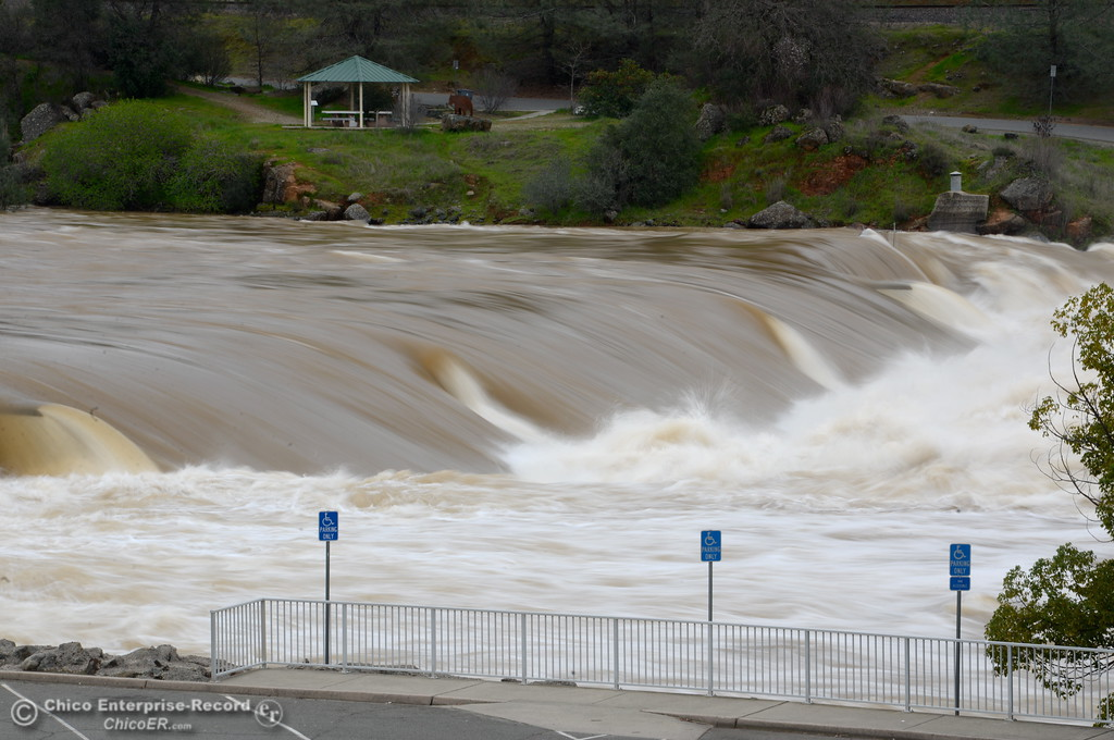 . The rising Feather River flows completely over the viewing platform near the Fish Barrier Dam Wednesday as the Lake Oroville Dam Spillway emergency continues in Oroville, Calif. Wed. Feb. 15, 2017. (Bill Husa -- Enterprise-Record)