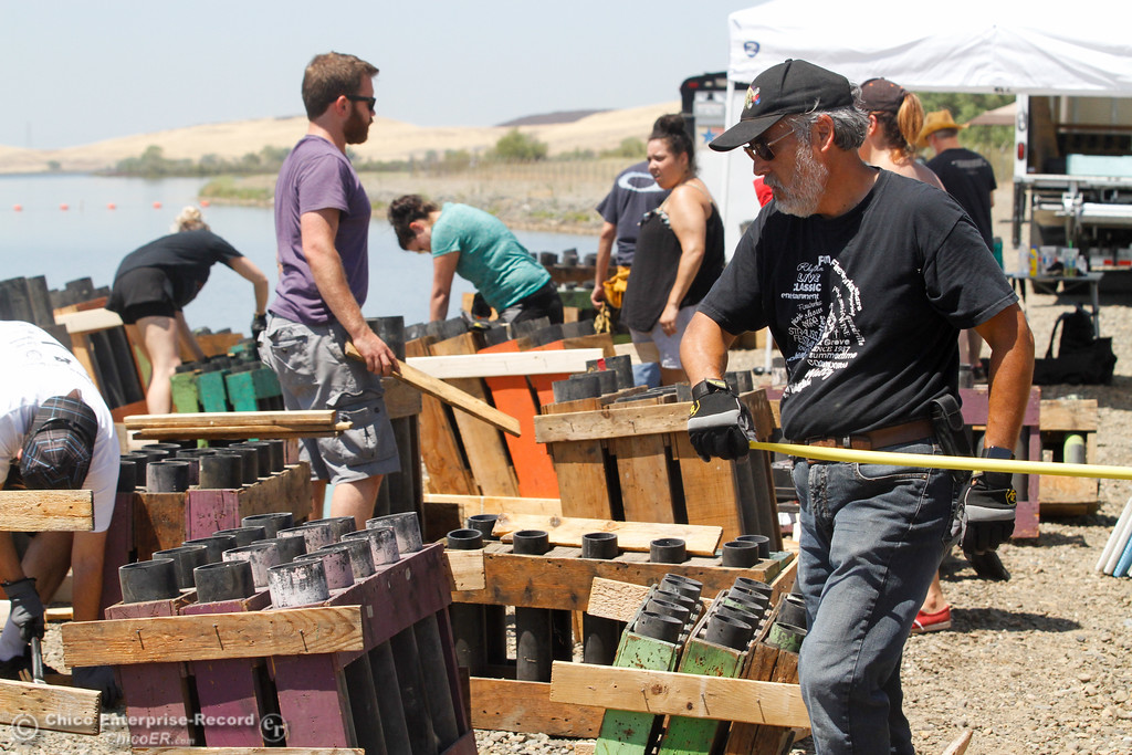 . Firework producer with Pyro Spectaculars Richard Bryant (right) arranges the tubes that hold the fireworks July 3, 2017 at the Thermalito Forebay in Oroville, California.  (Emily Bertolino -- Mercury-Register)
