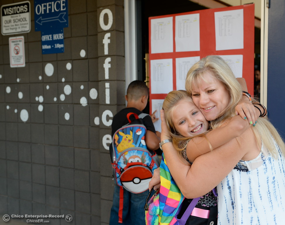 . Resource Teacher Gail Greb gets a big hug from incoming fourth grader Madison Mason as parents and students arrive for the first day of school at Wyandotte Academy in Oroville, Calif. Wed. Aug. 16, 2017.  (Bill Husa -- Enterprise-Record)