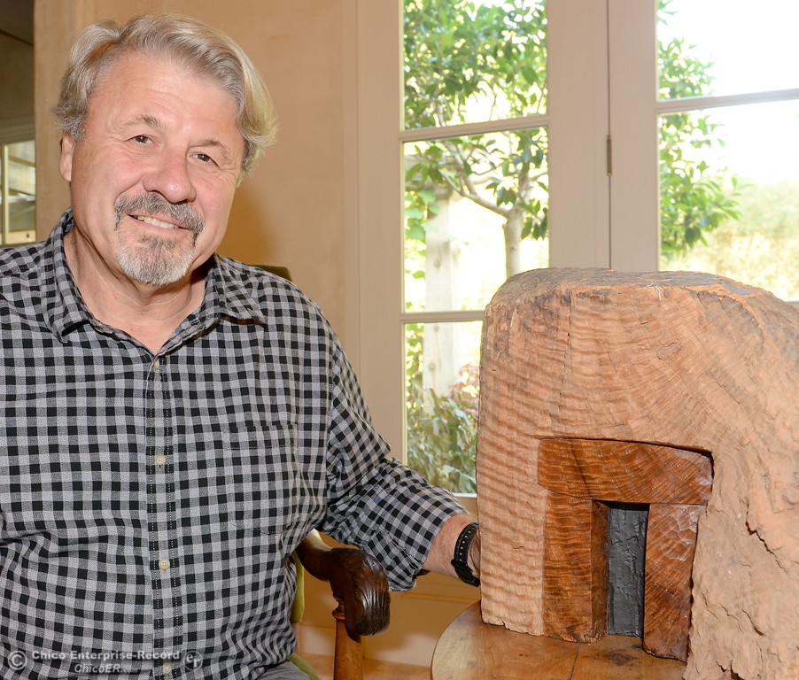 . Graham Hutton, Owner of Made in Chico smiles beside an artwork of his own at his Chico home Wed. Nov. 1, 2017. Hutton won a Mayors Arts Award this year for outstanding patron of the arts. Hutton also creates pieces for himself, some of which are on display at his home. (Bill Husa -- Enterprise-Record)