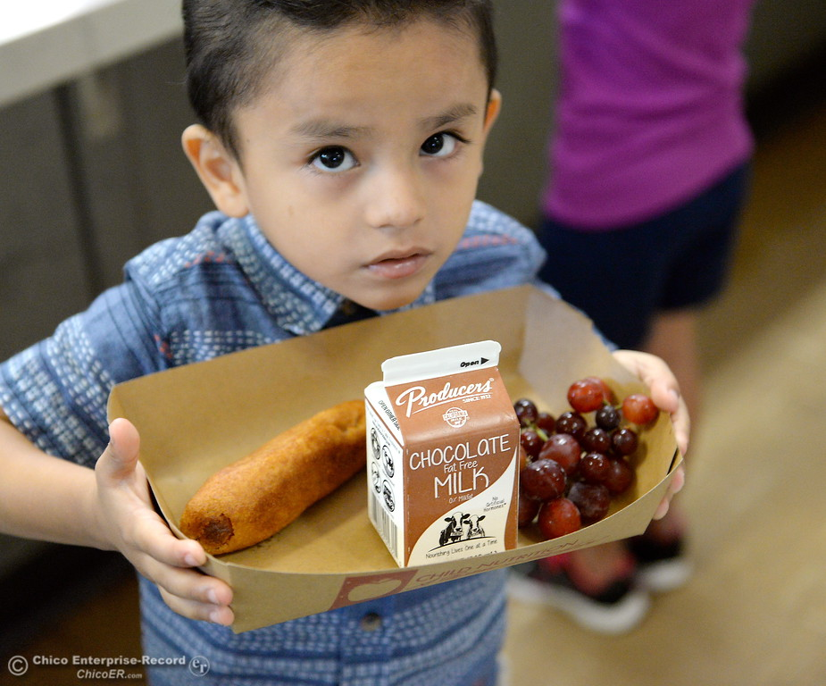 . Romeo Delgado-Ortiz walks with his lunch as students in Laura Manning\'s transitional kindergarten class enjoy lunch at Chapman Elementary School in Chico, Calif. Thurs. Aug. 24, 2017. (Bill Husa -- Enterprise-Record)