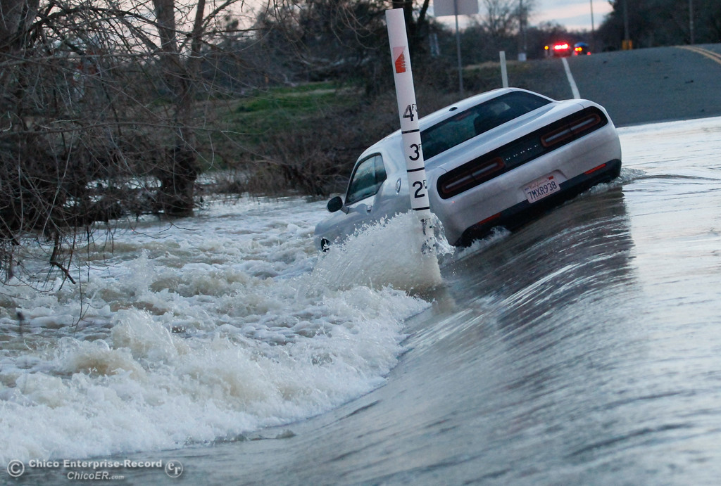 . Water rushes through a car that was swept off the road by deep and fast moving water January 23, 2017 along River Road near Ord Ferry in Chico, California. (Emily Bertolino -- Enterprise-Record)