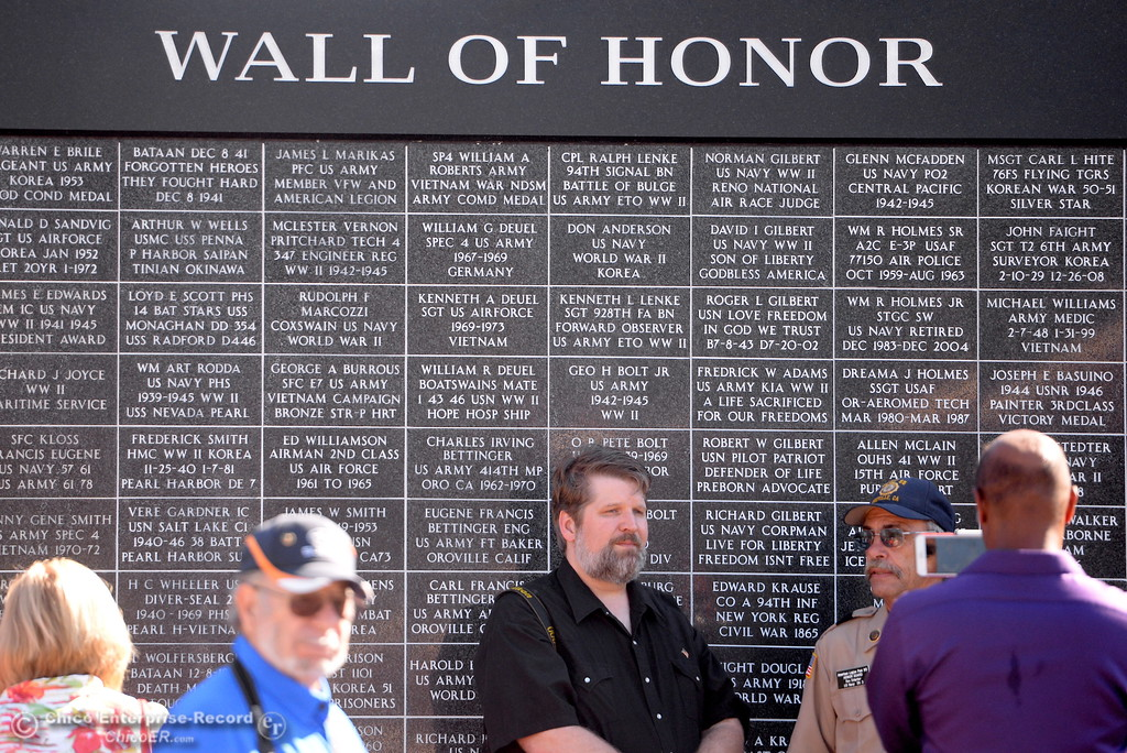 . Jeff Shaner, son of the late Stu Shaner stands beside the Wall of Honor during the Oroville Veterans Memorial Park opening ceremony Friday July 28, 2017. (Bill Husa -- Enterprise-Record)