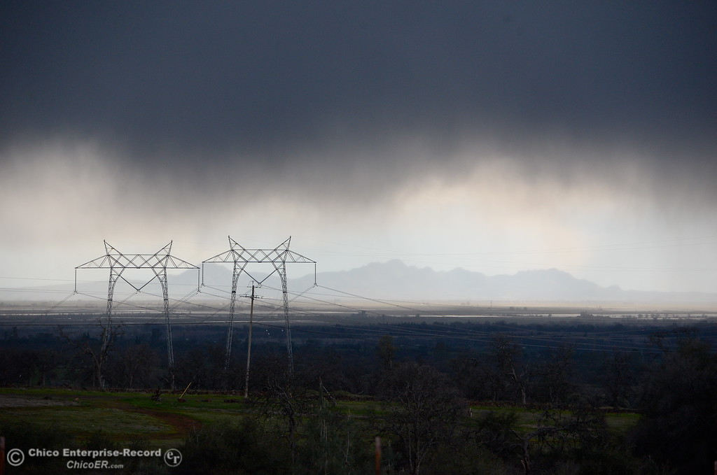 . A dark rain cloud is seen above Chico with the Sutter Buttes in the backround Wednesday Feb. 22, 2017. (Bill Husa -- Enterprise-Record)