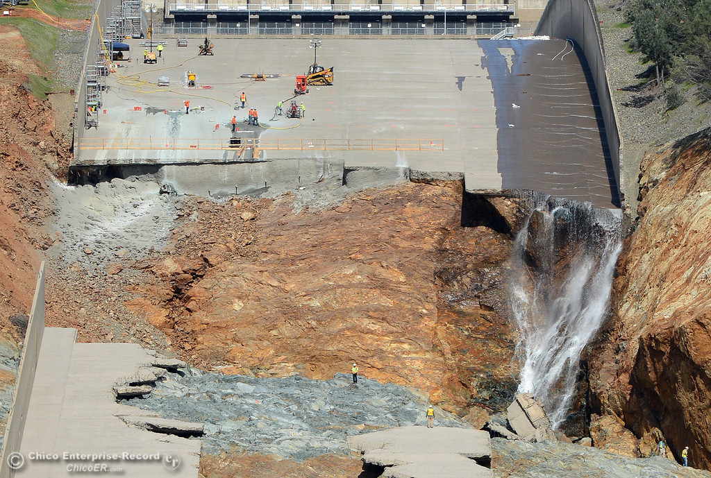 . Workers are seen on the slope Saturday, March 11, 2017, of the Oroivlle Dam spillway in Oroville, California. (Dan Reidel -- Enterprise-Record)