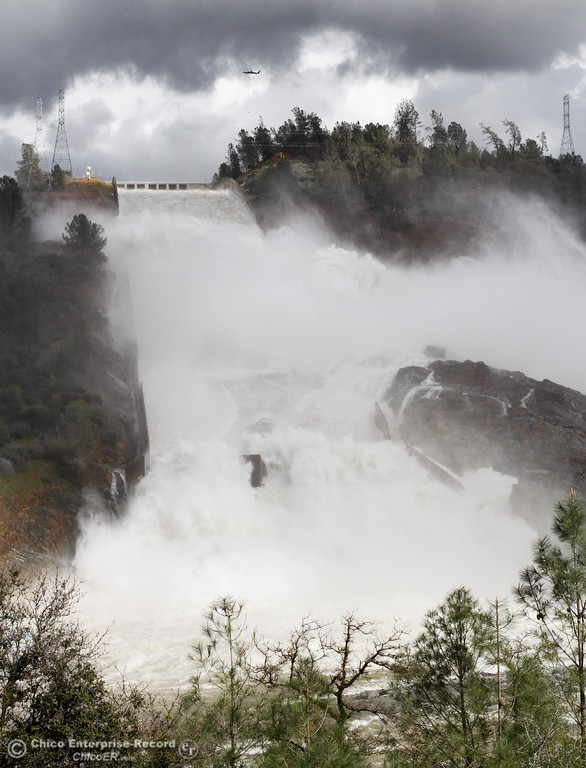 . Water continues to flow down the Oroville Spillway as the Department of Water Resources works to decrease to flow from 100,000 cubic feet per second to 80,000 cfs February 16, 2017 in Oroville, California. (Emily Bertolino -- Enterprise-Record)