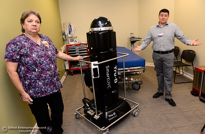 Kim Basham, Director of infection prevention and Cooper Cunningham, Director of Environmental Services talk about their disinfecting robot Tru-D during a demonstration of the device at Oroville Hospital in Oroville, Calif. Wed. June 7, 2017. (Bill Husa -- Enterprise-Record)