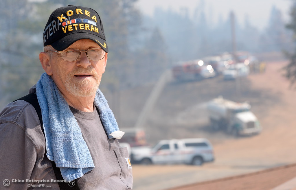 ". Lumpkin Road resident Gary Honroth had enough defensible space for fire crews to pull in and use as a staging area which ended up saving his house in the Ponderosa Fire area above Oroville, Calif. Wednesday Aug. 30, 2017. Honroth said ""It was so hot I thought the windows were going to blow in. The hand crew saved my house.\"" (Bill Husa -- Enterprise-Record)"