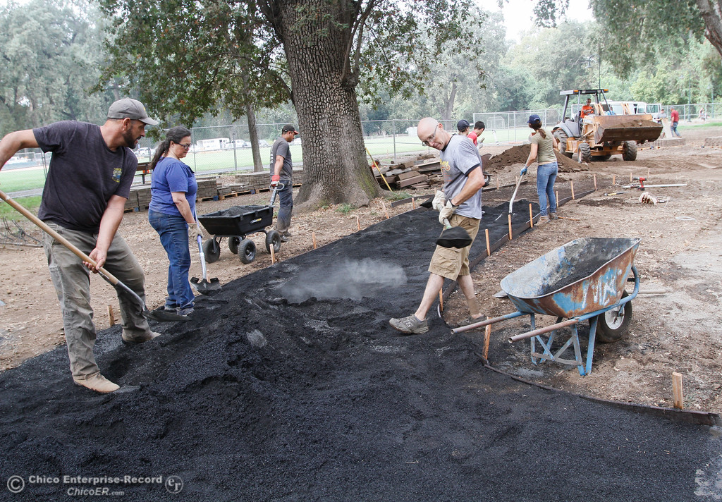 . Members of the Chico Sunrise Rotary Club work on redoing the entry way to Caper Acres September 15, 2017 at Bidwell Park in Chico, California. (Emily Bertolino -- Enterprise-Record)