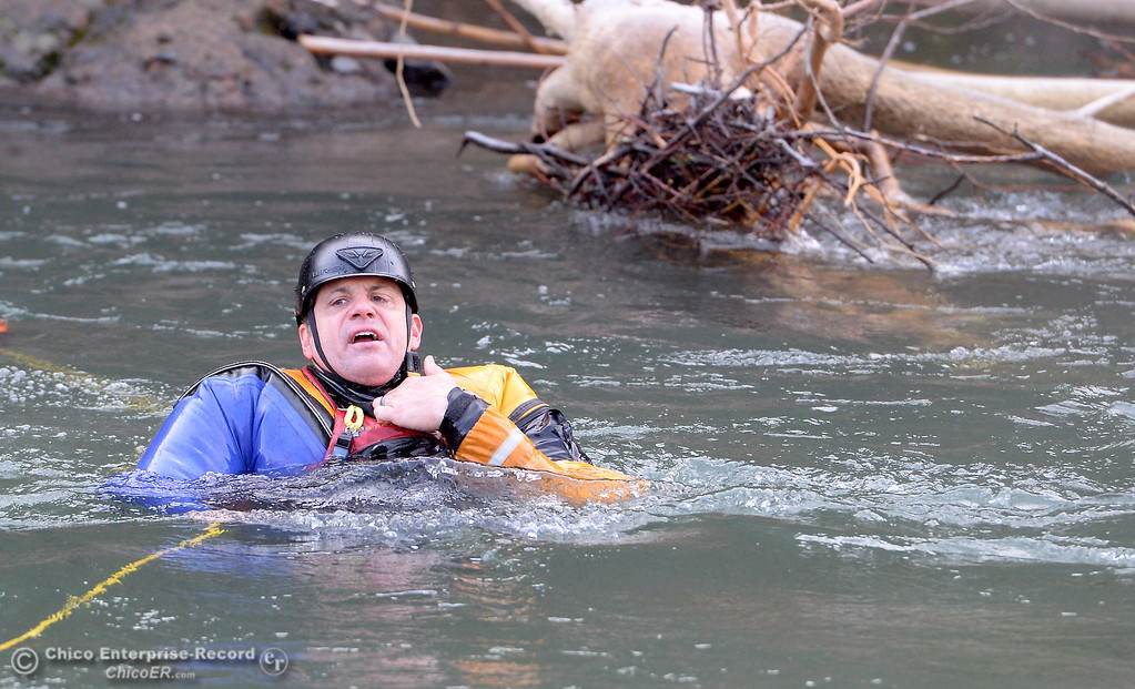 . CAL FIRE Instructor/Battallion Chief Matt Wallen acts as a victim in this scenario as he teaches firefighters from around California swift water rescue techniques during a class held along Butte Creek downstream from the Honey Run Covered Bridge in Chico, Calif. Friday Jan. 6, 2017. (Bill Husa -- Enterprise-Record)