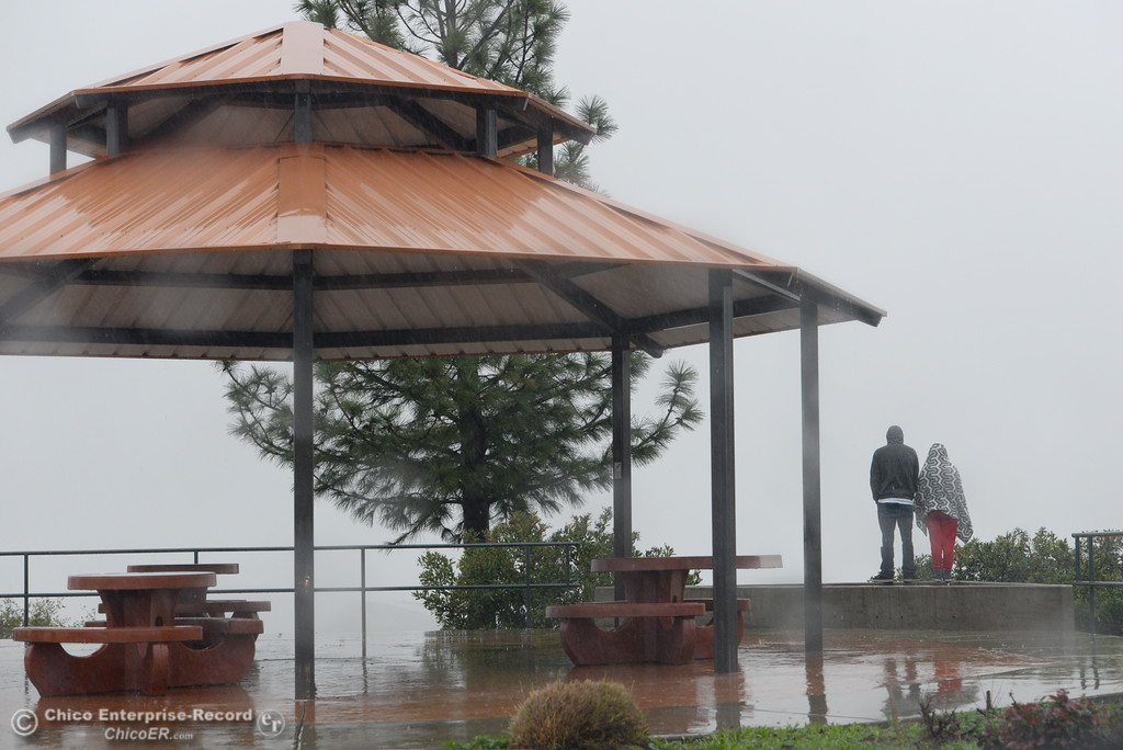 . People weather the rain to check out Lake Oroville from the Vista Point above the dam Thursday Feb. 8, 2017.   (Bill Husa -- Enterprise-Record)