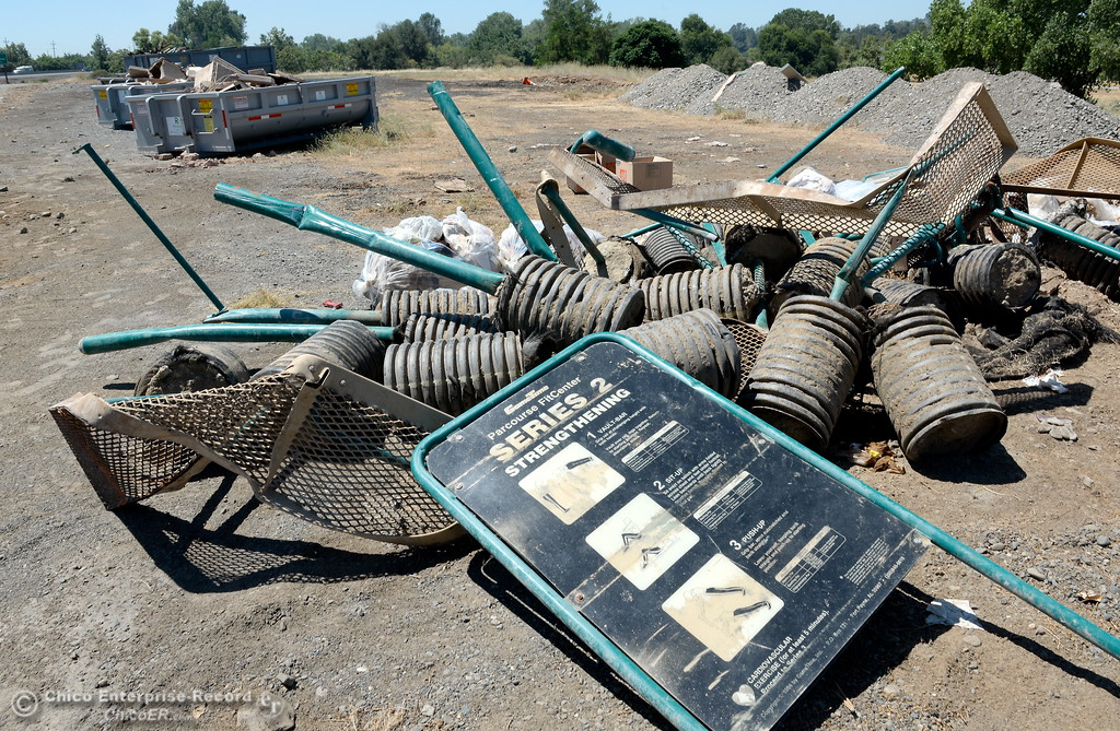 . Five large debris bins along with a big pile of metal and concrete items are seen following a big cleanup day last week, Riverbend Park shows improvement however much remains to be done seen here Monday June 26, 2017.  (Bill Husa -- Enterprise-Record)