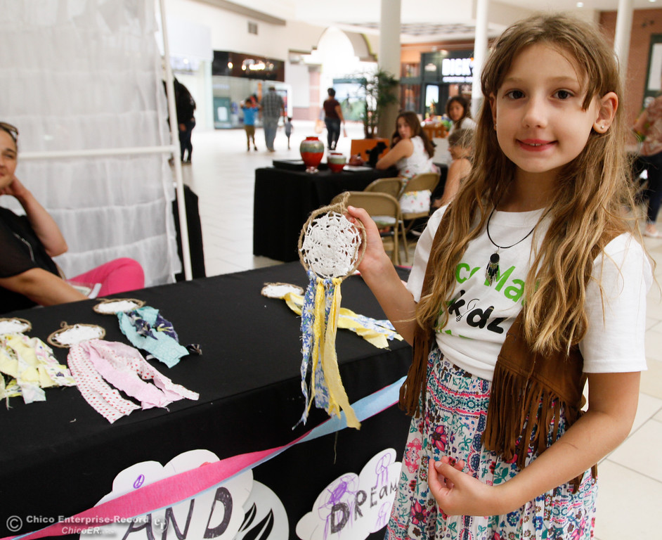 . Isabelle Bergstrom, 8, holds up a dreamcatcher from her shop Izze B\'s Recycling during the Biz Kids showcase Saturday July 29, 2017 at the Chico Mall in Chico, California. (Emily Bertolino -- Enterprise- Record)