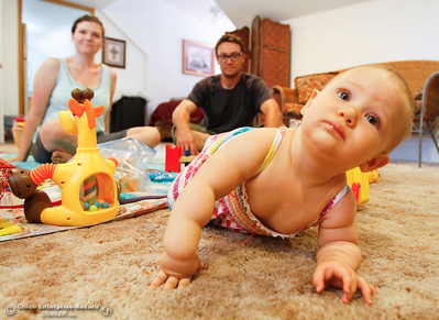 Husband & wife Cody Richardson, Jennifer Davis and baby Pearl's home was destroyed during the Wall Fire are planning on moving to Sacramento Wednesday July 26, 2017 in Chico, California. (Emily Bertolino -- Enterprise-Record)