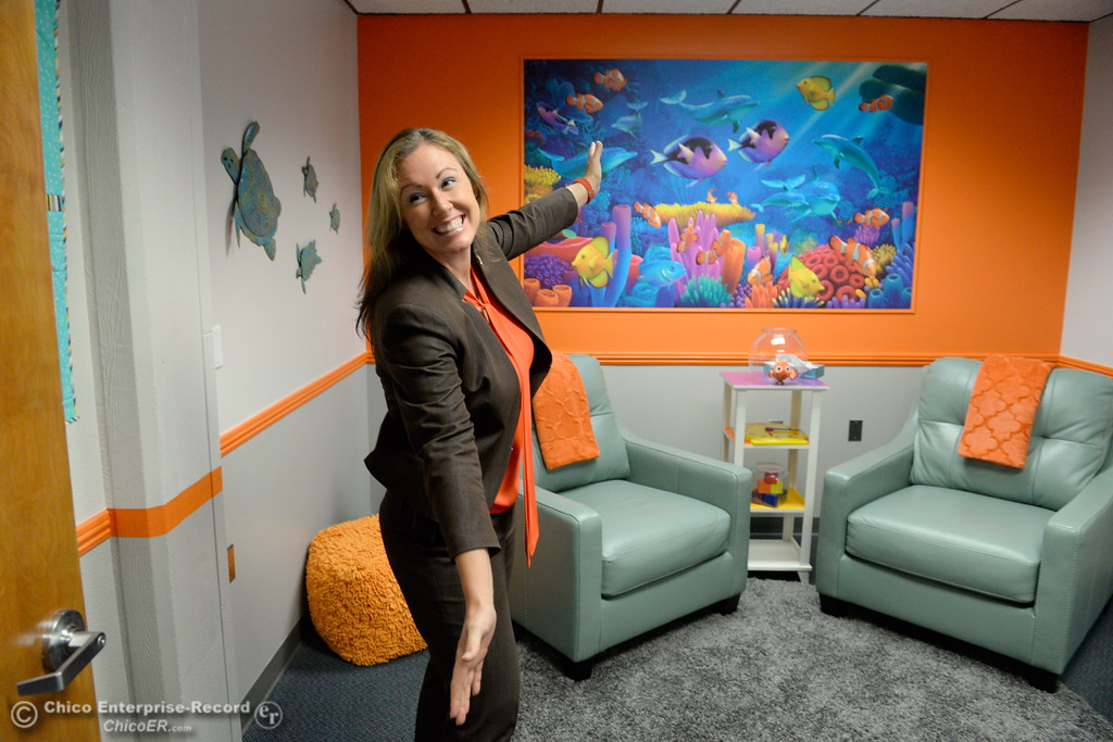 . Child Abuse Investigator Sabrina Ostberg gestures inside of the new interview room during the grand opening ceremony of the new Child Abuse Response Team room located in the former County Clerk space at 25, County Center Drive in Oroville, Calif. Tues. Aug. 22, 2017. Bill Husa -- Enterprise-Record)