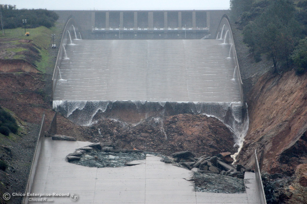 . The hole from the damaged Oroville Dam controlled Spillway is seen prior to the water release on Thursday. The hole continues to grow larger as water is released Thursday Feb. 8, 2017.  Erosion along the left side continues to increase as the spillway falls apart. (Bill Husa -- Enterprise-Record)