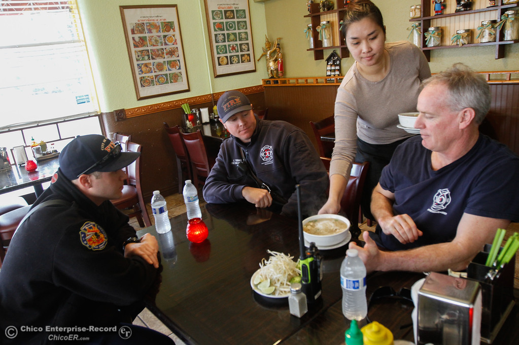 ". Pho Noodle House in downtown Oroville was open to serve free meals to public service offices only today, Sarah Thammavong brings Oroville Firefighters Russell Williams, Chris Tennis and Erik King bowls of pho February 15, 2017 in Oroville, California. A sign out front reads, ""Thank you for your services and keeping our families safe! Serving you today for serving us.\"" (Emily Bertolino -- Enterprise-Record)"