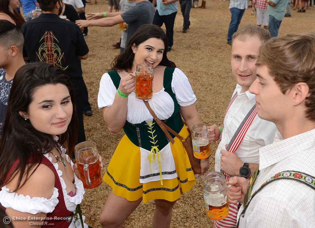 . Left to right, Brittany Mitchell, Allison Mitchell, Patrick Jameson and Arlen Layton enjoy a beer as Sierra Nevada Brewing Co. holds its first of four Oktoberfest celebrations Friday, Sept. 29, 2017, in Chico, California. (Dan Reidel -- Enterprise-Record)