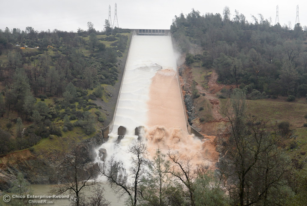 . Muddy water flows from the eroding section of the spillway as DWR performs a 20,000 cfs test on the damaged Oroville Dam Spillway Wednesday Feb. 8, 2017. (Bill Husa -- Enterprise-Record)