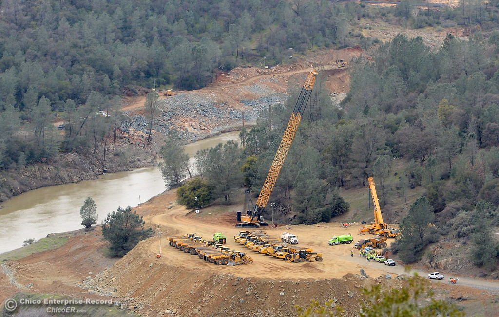 . A landing where trucks are parked below the Lake Oroville Dam is seen from the Vista Point Tues. March 7, 2017. (Bill Husa -- Enterprise-Record)