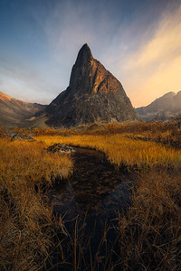 A uniquely shaped mountain lit with the last light of the day