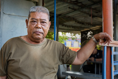 the security guard at the train graveyard, Bang Sue District, Bangkok